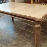 custom walnut and curly maple dining table with leaf stored