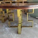 oval walnut dining table with brass base