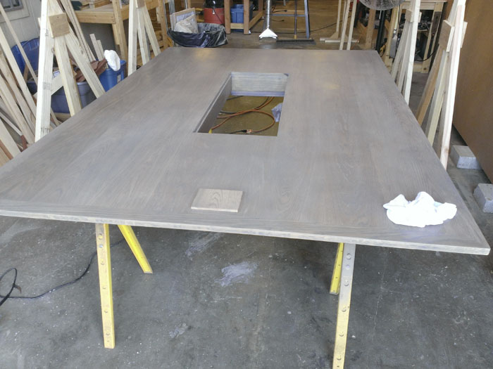 This is an image of Austin Joinery's Grey Oak Table with Center-Through.