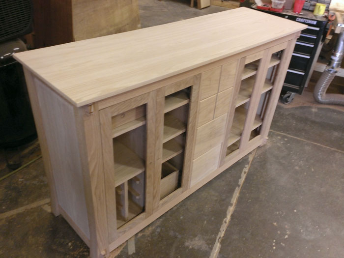 This is an image of the build process of the handmade Colorado Media Center by Austin Joinery.