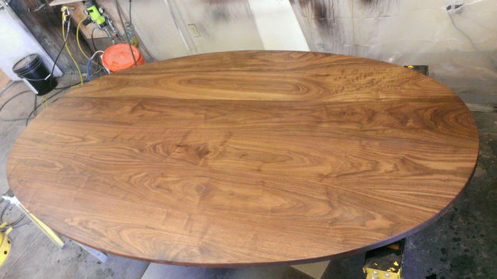This is an image of the build process for Austin Joinery's Oval Walnut Table with Brass Bases