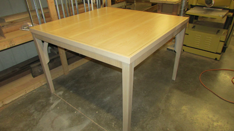This is an image of the Custom Curly Maple and Rift Sawn Oak Table
