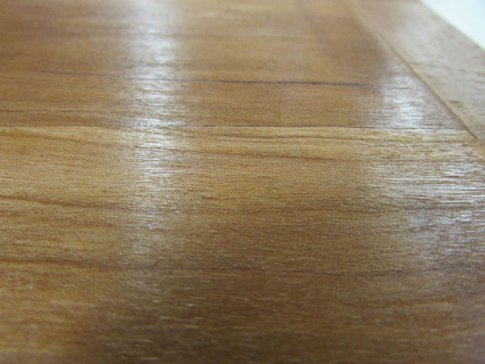 This is an image of an iron left too long on furniture - from the blog of Austin Joinery.