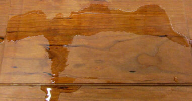 This is an image of a watermark on a custom piece of furniture.