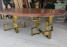 oval walnut table with brass base 2